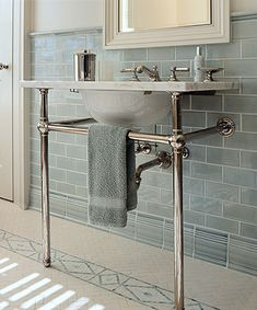 bathroom sink with chrome stand.  Blue metro tiles