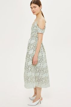 Opt for total sophistication in this laser cut bardot dress in mint, with trim detail and skinny straps. In a midi cut, it comes with a gorgeous full skirt. Take the look up a notch with court shoes and a statement clutch.