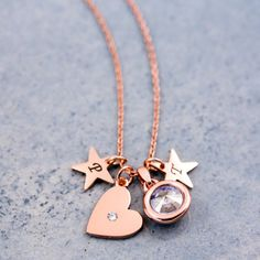 A beautiful heart necklace made using gorgeous rose gold colour charms. A stunning cluster charm necklace. The main charm is a lovely heart