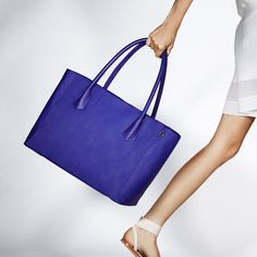 """Meet your new best friend - the Dagne Dover Tote. With pockets for your laptop, metrocard, water bottle, lipgloss and wallet, The Tote is your ideal laptop and travel bag. """"The solution to your black hole handbag struggle!"""" - Huffington Post."""