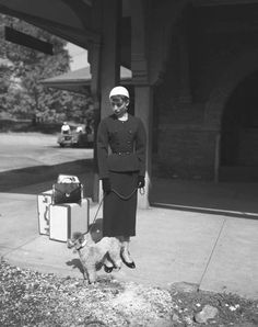 "The actress Audrey Hepburn (as Sabrina Fairchild, with the Poodle called ""David"") photographed during the filming of ""Sabrina"" at the train station of Glen Cove (in Nassau County, on the North Shore of Long Island), New York (USA), in October 1953."