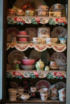 I love the floral trim on  the front of the shelves.