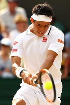 Kei Nishikori of Japan plays a backhand against Ernests Gulbis of Latvia during their Men's Singles fourth round match on day seven of the Wimbledon Lawn Tennis Championships at All England Lawn Tennis and Croquet Club on July 9, 2018 in London, England.