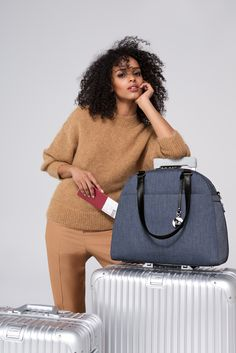 The O.G. & O.M.G in Heather Slate Blue by Lo & Sons - your favorite travel carryalls, now available in a casual yet business-ready neutral. Effortlessly marrying form with function, the O.G. and O.M.G. have a zippered compartment for shoes, a sleeve to attach to luggage handles, and a front pocket to keep travel accessories organized.