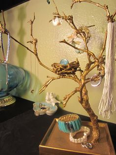 DIY jewelry tree! Use a tray from the Goodwill and a branch from your yard