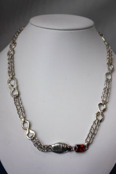 Cobra inspired necklace by Trung Le- level 2 jewellery class. Small links are made with Roman chain links, large snakes have mesh texture applied, other connecting links have tiny gold  leaves as decorative elements. Stunning! Photo by Wayne Jones