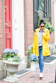 Yellow rain parka, blue tones, jeans, button up shirt, shoes, flowers, sunglasses, chic, streetstyle