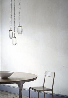OCHRE's celestial pebble light, whippet table and leather sable chair