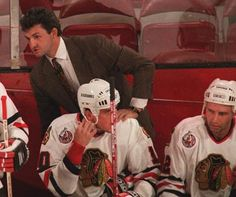 Darryl behind the Hawks bench with Brent (far right) in uniform