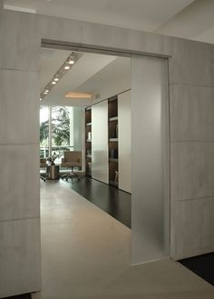 Another view inside the sleek Mizner Park residence designed by Eric Dyer in Florida _ - July 06 2019 at Interior Barn Doors, Interior And Exterior, Contemporary Internal Doors, Contemporary Style, Folding Closet Doors, Hanging Barn Doors, Modern Interior Design, Modern Decor, Innovation Design