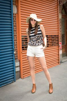 Simple white shorts are great for balancing out a busier mixed-print top.