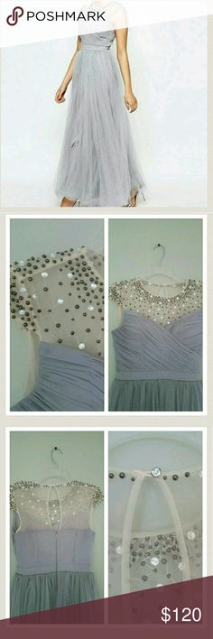 Gray bridesmaid dress Tulle dress with a sweetheart neckline.  Top of dress with diamond rhinestones and bronze beads.  Resembles the fairytale dress style.  Two layers of tulle. - Fabric:     -outer 1: 100% polyester     -outer 2: 100% nylon    -lining: 97% polyester, 3% elastane ASOS Dresses Wedding