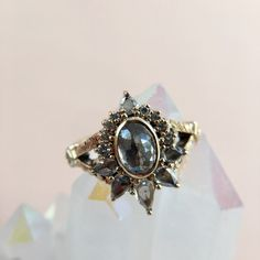 *This ring will be available for sale on May 1st, pre-sale inquiries contact catherine@gemhunt.co* Why I Love It Strong, fierce, and feminine need only to apply to be this ring's future owner. With a smoky salt and pepper diamond as the center stone, it bewitches you with the depth of it