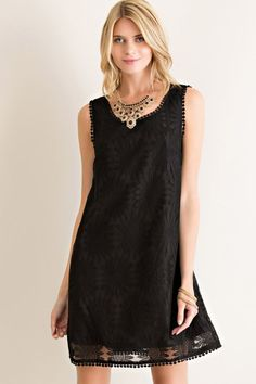 This chic lace shift dress features adorable daisy lace details. Accented with scalloped trim and a sweet keyhole button back, this is a super cute alternative to a classic little black shift dress. G