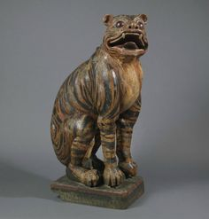 A very rare painted ashwood figure of a seated tiger. Probably Korean, Joseon dynasty or century. Height: cm, 34 in. New York, Korean Art, Art Object, 19th Century, Lion Sculpture, Asia, Objects, 24 March, Statue