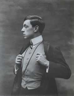 Very interesting photo from the very early 1900's. He appears to be wearing a frock coat with stain-faced lapels. Also note how high his vest collar is, as well as the shirt collar itself, which is very high, square, and starched.