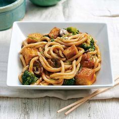 Japanese udon noodles, which cook in a matter of minutes, soak up all of the slightly spicy umami-rich sauce in this stir-fry. Cubes of golden tofu make the meat-free supper substantial. Tofu Recipes, Asian Recipes, Vegetarian Recipes, Vegetarian Soup, Vegetarian Dinners, Dinner Recipes, Ethnic Recipes, Tofu Noodles, Recipes With Udon Noodles