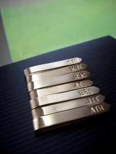 For the groomsmen -- personalized tie clips