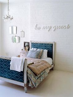 Fabric headboard, patchwork quilt, white exposed brick walls. For more spare bedroom ideas, click the picture or see http://www.redonline.co.uk