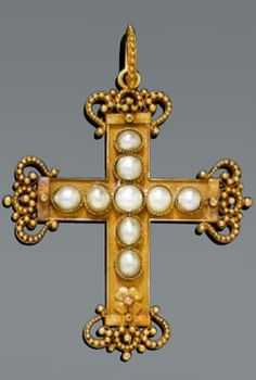 An antique pearl and gold pendant, circa 1880. Cross pendant with a matte-finished surface, set with 9 half Oriental pearls, the ends of the cross decorated with textured volute motifs, mounted in yellow and rose gold . 6.5 x 4.7 cm. #antique #cross #pendant
