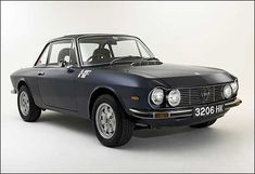 lancia fulvia coupé like my Mum had.. dark blue, red leather interior.. reg: JNJ 501L