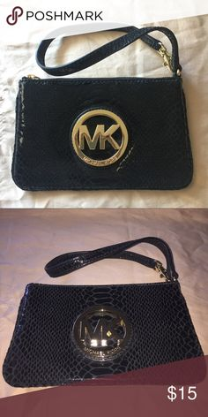 fb65adc781be Black authentic Michael Kors wristlet Black and Gold MK wristlet. Never used  before Michael Kors