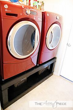 Build shelves under washer/dryer for hampers