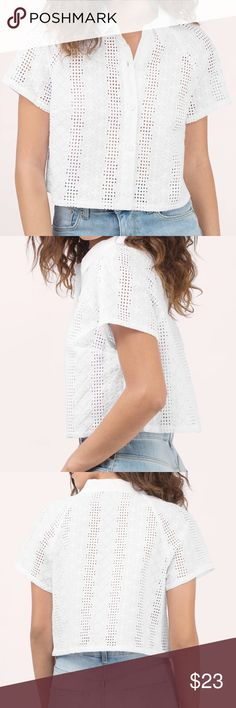 Tobi Cropped Button Down T-Shirt Brand new, button down white eyelet t-shirt. Shirt is cropped and has a collar. Pairs great with high waisted shorts, jeans or skirt.     Feel free to ask questions or make an offer! Bundles of 2 or more items save 20%! No Trades! Tobi Tops Crop Tops