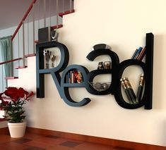 such a cool shelf. this would be cool in a home office or kids playroom! Great wall art too!