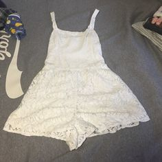 Abercrombie and Fitch white romper Abercrombie and Fitch white romper, size small, worn once to a graduation dinner, only visible stains or damage are pictured Abercrombie & Fitch Dresses