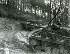 Hurtgen gallery 4 Troops ride 3rd Armored Division tank destroyers up a narrow, muddy road in the Hürtgen Forest. The overall goal of the US advance in the German woodland was to pierce the forest, cross the Roer River, and reach the Rhine. But tangled woods, impassable roads, and dug-in enemy firepower turned the assault into a bloodbath.