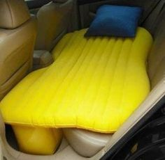 "Inflatable car bed. I would have loved this as a kid!!  I remember sleeping on the ""hump"" on the way to meetings."