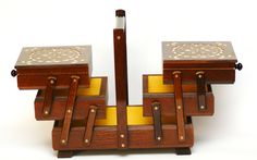 Dark  hand crafted wooden sewing box  https://www.justwhatuwant.co.uk/product/dark-hand-crafted-wooden-sewing-box/
