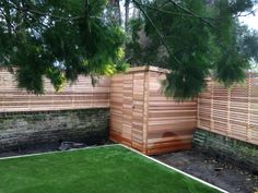 Cedar slats on this walk-in bike shed we installed along with matching slatted fences