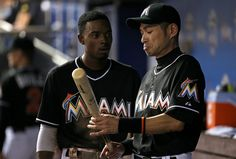 Ichiro Suzuki and Dee Gordon Photos - Ichiro Suzuki #51 talks with Dee Gordon #9 of the Miami Marlins after scoring during a game against the Philadelphia Phillies at Marlins Park on August 22, 2015 in Miami, Florida. - Philadelphia Phillies v Miami Marlins #Ichiro #イチロー
