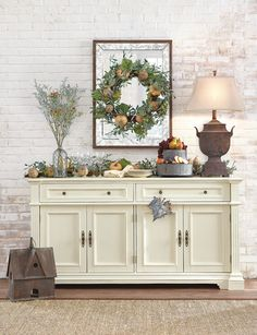 Bring the feeling of fall indoors with ease simply by adding harvest decor like a wreath. HomeDecorators.com