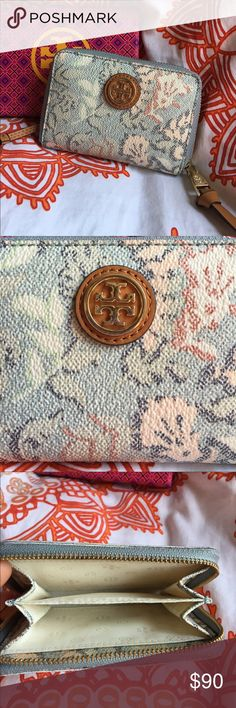 Tory Burch small wallet This is a small Tory Burch wallet that was purchased at Nordstrom. It is in excellent condition. The pattern is a rare print. This is perfect if you are like me and only carry around credit cards and you license. It also has a key fob (cut out of photo) on it to attach your keys. Perfect for everyday use or to use in a small cross body bag. Tory Burch Bags Wallets
