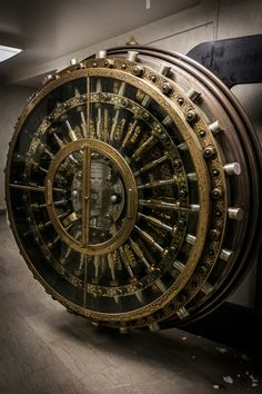Antique Bank Vault Door - Two people open and close the Vault. Weighs 22 Tons.