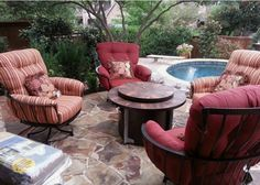 "O.W. Lee Monterra swivel club chair with a 42"" Santorini fire pit Yard of the Month - July - Yard Art Patio & Fireplace"