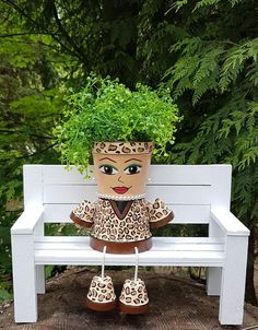 Best 12 This elegant flower pot people planter features a leopard print outfit with matching headband and boots. Pearl bead earrings and necklace finish her look. Add your favorite flowers or plant to bring her to life with a stylish hair do. A unique and Clay Pot Projects, Clay Pot Crafts, Diy Home Crafts, Garden Crafts, Flower Pot Art, Clay Flower Pots, Flower Pot Crafts, Flower Pot People, Clay Pot People