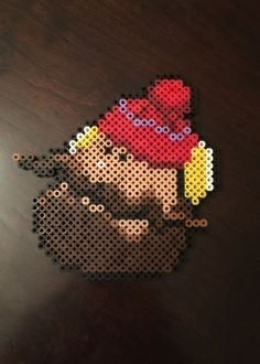 Rudolph the Red-Nosed Reindeer Inspired 8 Bit Character - Yukon Cornelius via eb.perler. Click on the image to see more!