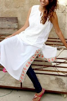 Simple kurti with embroidered slits, classic summer, but ditch the black tights with white and floral kurti ladies , opt for white or red