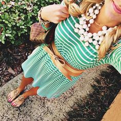 green and white stripe dress with brown leather bow belt and statement necklace