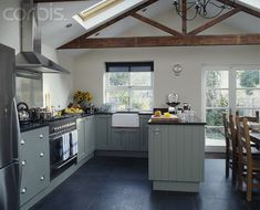 Vaulted ceiling, skylight, exposed wood truss.  like this for showing architecture in large great room- say @ sarah's!  theresa
