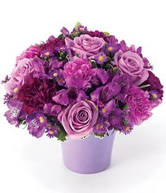 Short version but in clear vase w/purple ribbon: Purple roses, purple alstroemeria and lavender carnations in vase