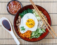 Do you know this #delicious #Korean dish: the #Bibimbap pronounce bi bim bap ?  It is a bowl of warm white rice accompanied of sautéed #vegetables  soy sauce chili pepper paste sliced meat and topped with a fried egg. We #love it what about you?  #bonappetit #paleo #foodporn #lowcarb #food #yummy #cooking #healthyfood #diet #dieta #cleaneating #lostweight #bonappetit #fitness #slimmingworld #recipe #instafood #getfit #happy #fun #superfood #protein #bio #fitness #koreanfood  by lineavi