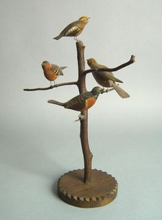 "Realized Price: $ 1404   Carved and polychrome bird tree, early 20th c., 14 1/4"" h."