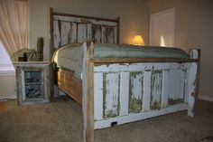 Headboard and footboard made from repurposed doors.. I might finish them differently but the idea is excellent!