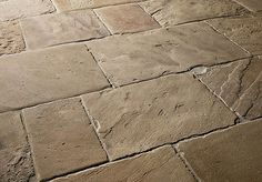 Traditional natural stone floor tiles by Lapicida.com.