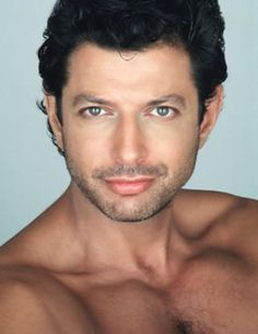 Jeff Goldblum. I can't help but find him attractive. Especially when he has those eyes and pretty pecs